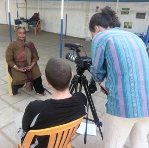 Sara Gadala being interviewed by Dan